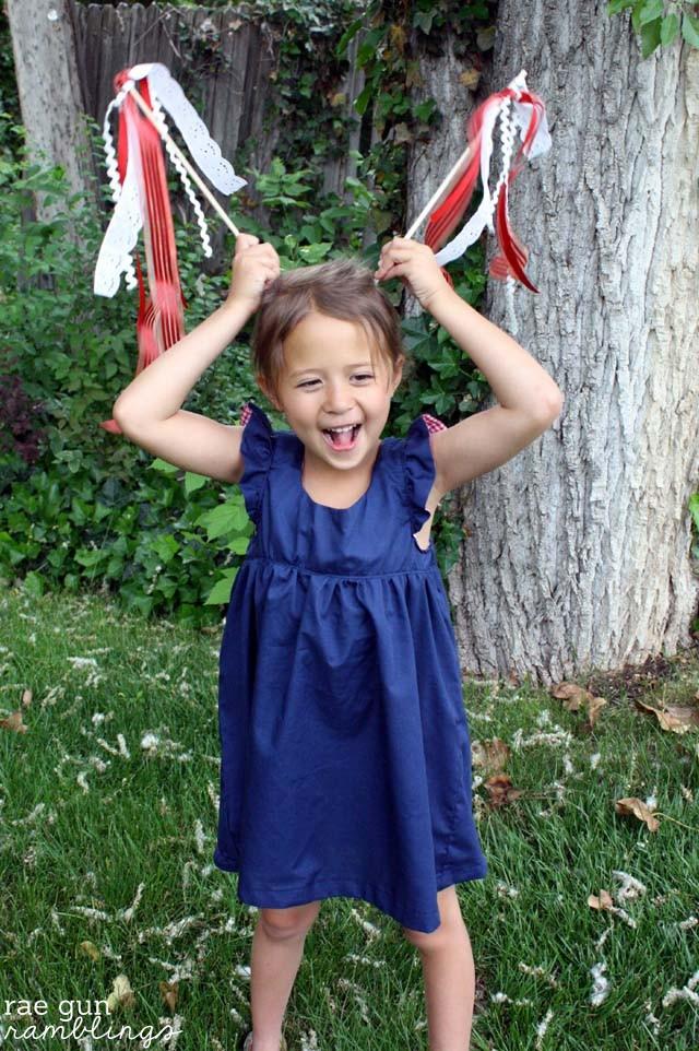 Make simple ribbon wands with craft scraps and wooden dowels. Tutorial at Rae Gun Ramblings