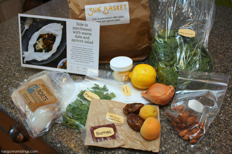 Sole fish packets with spinach and warm apricot and date salad recipe