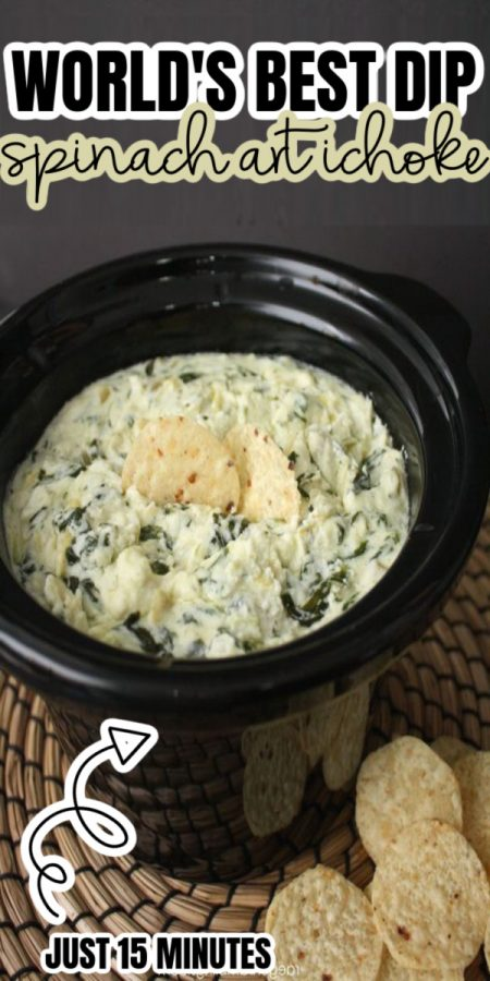 crock pot full of spinach artichoke dip and chips