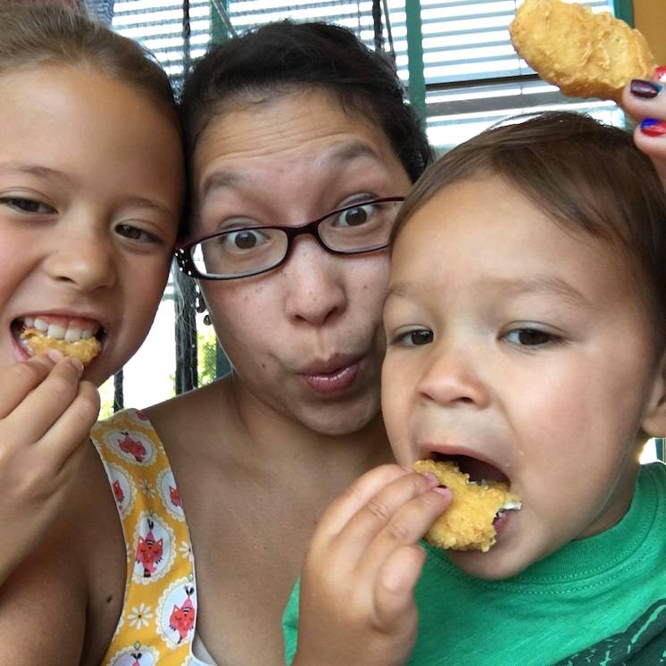 Family eating McDonald's chicken nuggets