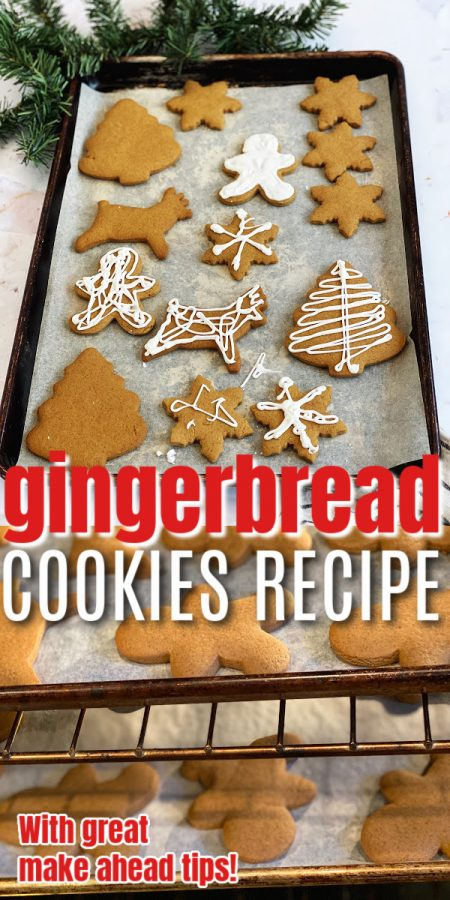 plate of christmas gingerbread cookies and trays baking